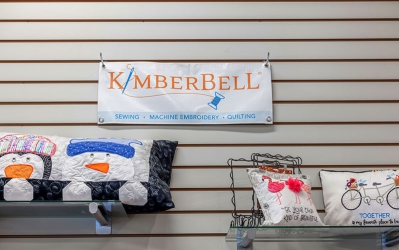 kimberbell sign with embroidery projects below